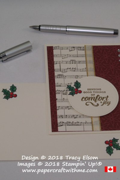Christmas card featuring embossed 'comfort & joy' sentiment with holly embellishment and music background created using the Timeless Tidings, Peaceful Poinsettia and Sheet Music Stamp Sets, all from Stampin' Up!