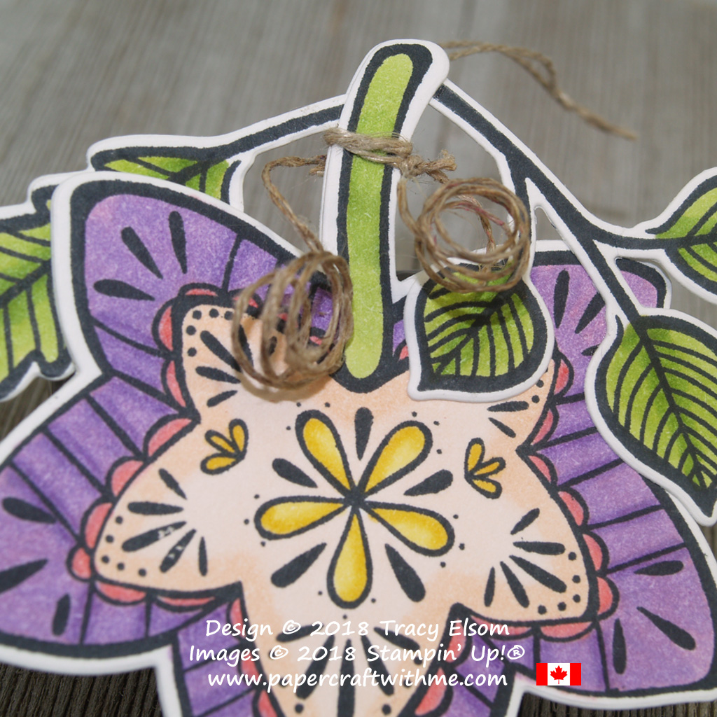 Closeup of large brightly coloured leaf gift tag created using the Falling for Leaves Stamp Set and coordinating Detailed Leaves Thinlits from Stampin' Up, showing curled linen thread tendril embellishment.
