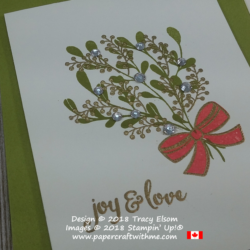 Close up of Christmas card with mistletoe bouquet and joy and love sentiment from the Mistletoe Season Stamp Set from Stampin' Up!