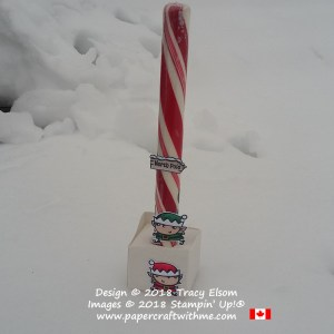 Large north pole candy cane decorated using images from the Signs of Santa Stamp Set and Stampin' Blends alcohol markers from Stampin' Up!