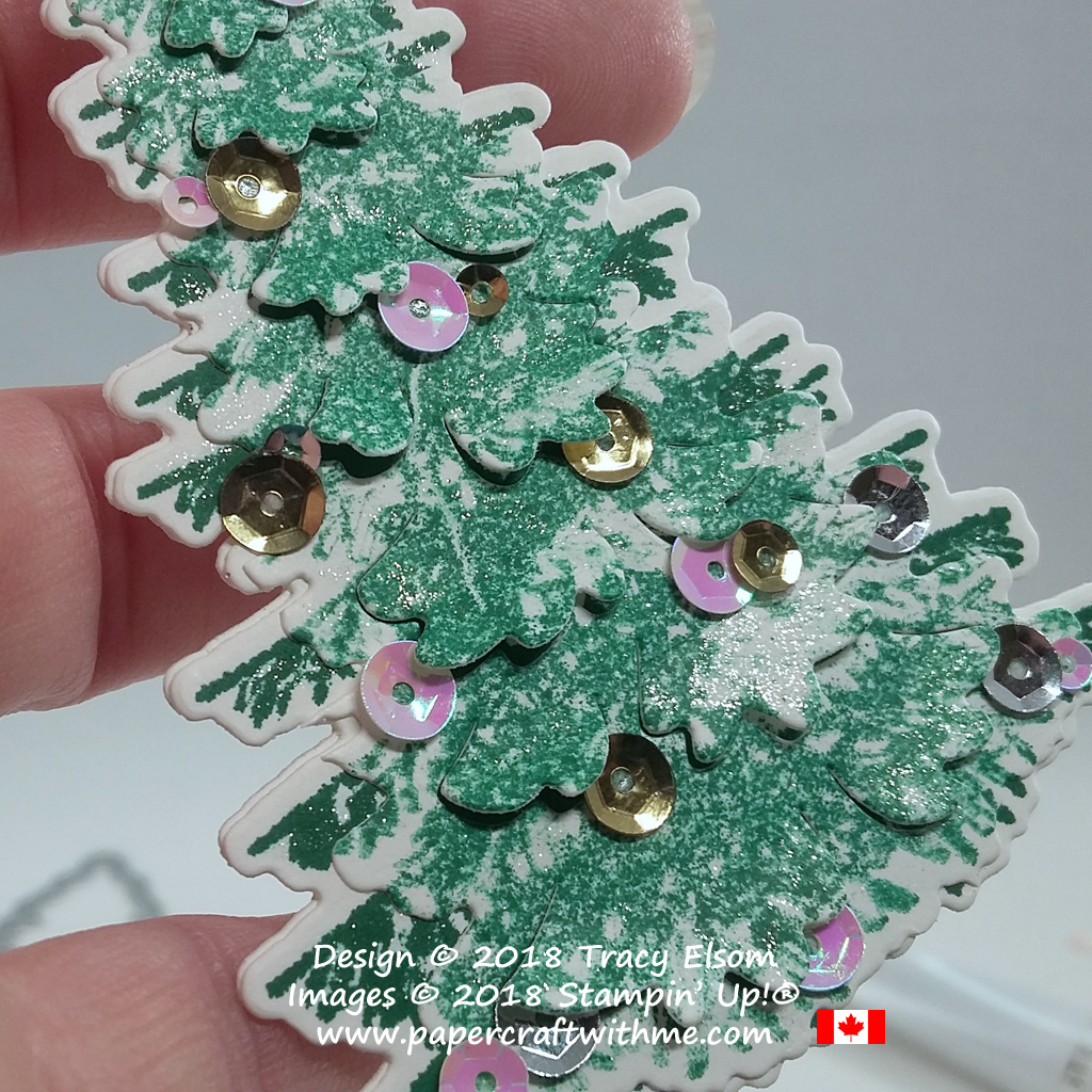 Close up of large Christmas tree gift tag created using the Winter Woods Stamp Set and coordinating In The Woods Framelits Dies from Stampin' Up! Sequins help keep the cut branches lifted.