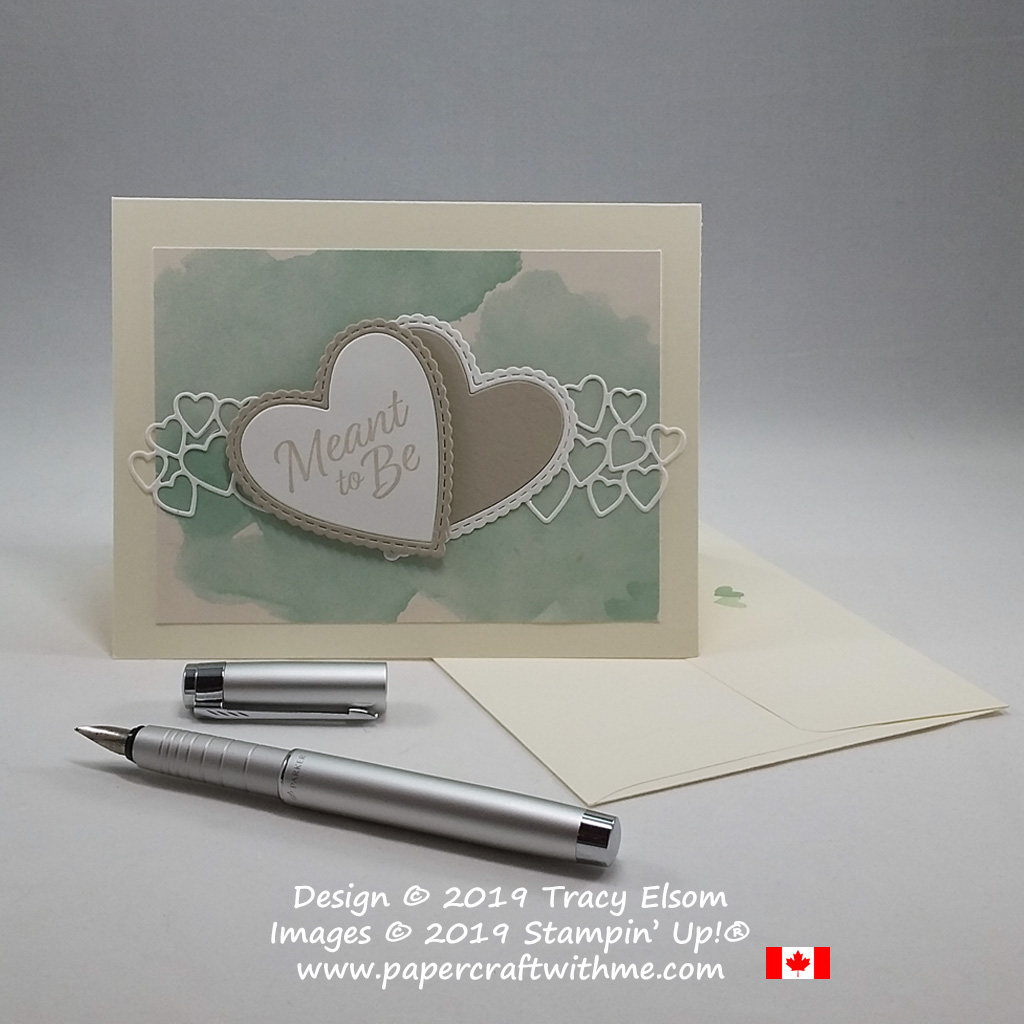 Layered hearts on wedding card in non-traditional colours on a faux watercoloured background created using the Meant To Be Stamp Set and coordinating Be Mine Stitched Framelits from Stampin' Up!