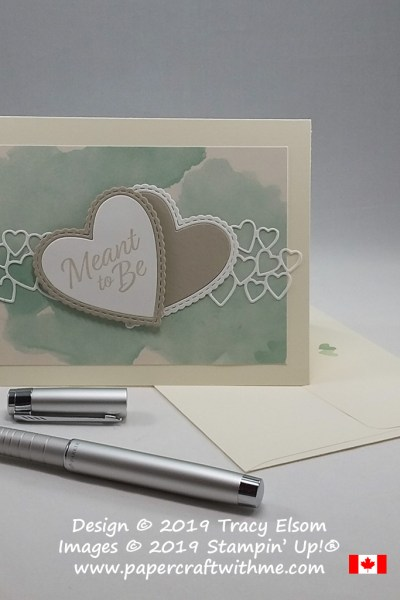 Layered hearts on wedding card in non-traditional colours on a watercoloured clouds background created using the Meant To Be Stamp Set and coordinating Be Mine Stitched Framelits from Stampin' Up!