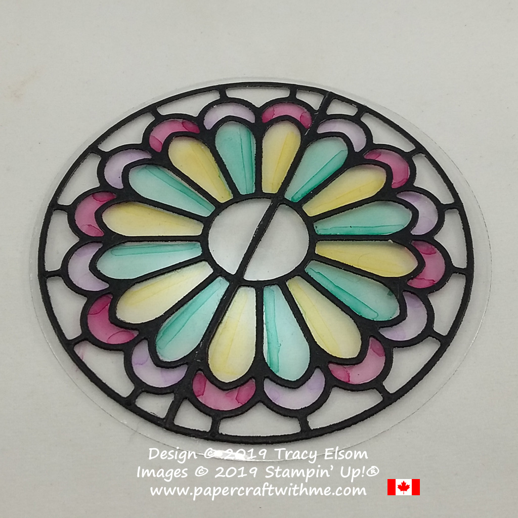 Colouring on acetate to create a faux stained glass effect.