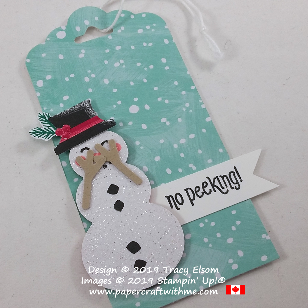 Close up of gift tag with snowman arms positioned so he's peeking through his fingers. Created using the #Elfie Stamp Set, Let It Snow Paper and Snowman Builder Punch from Stampin' Up!