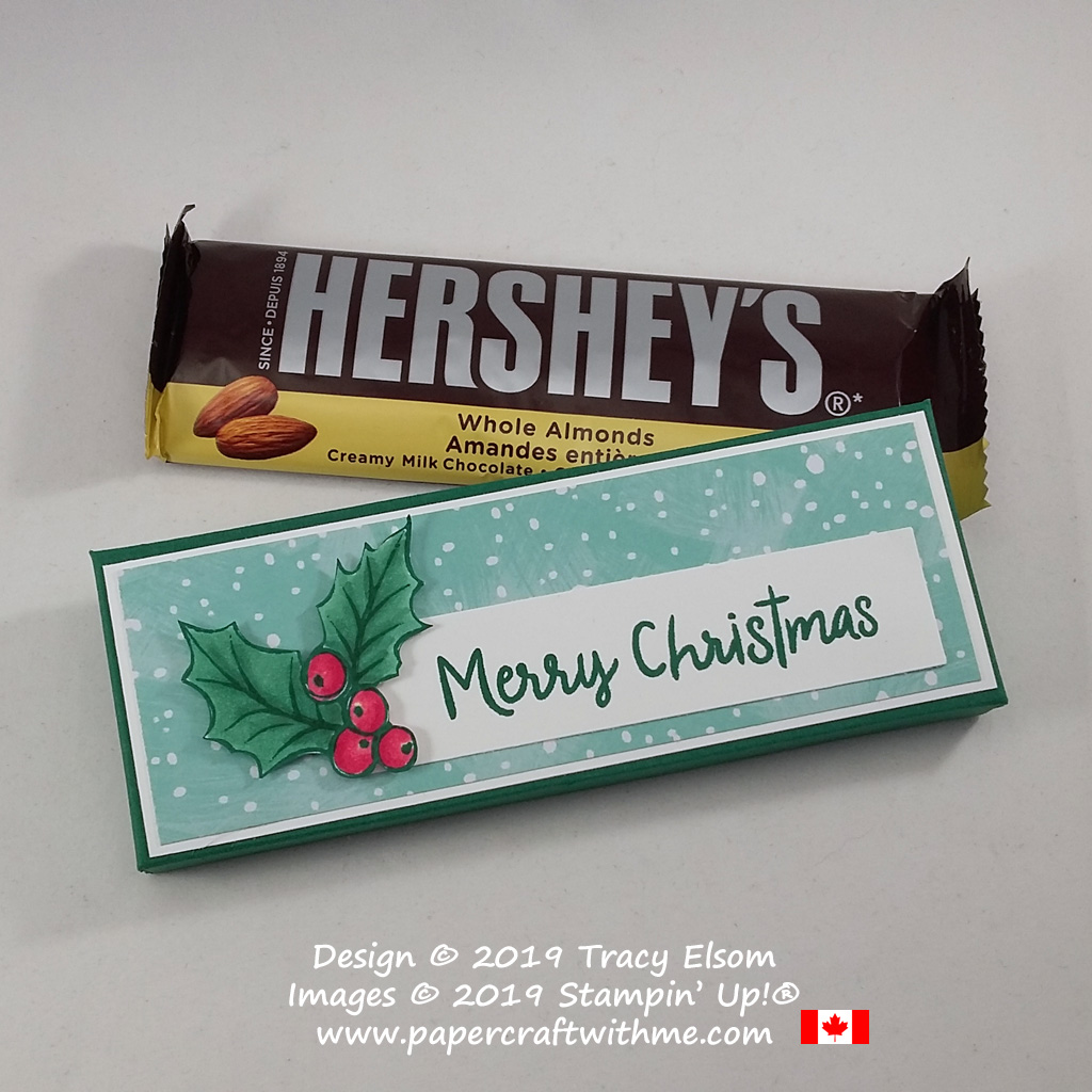 "Handmade box for a Hershey's chocolate bar decorated using a holly image and ""Merry Christmas"" sentiment from the Christmas Gleaming and Snowman Season Stamp Sets from Stampin' Up! #papercraftwithme"