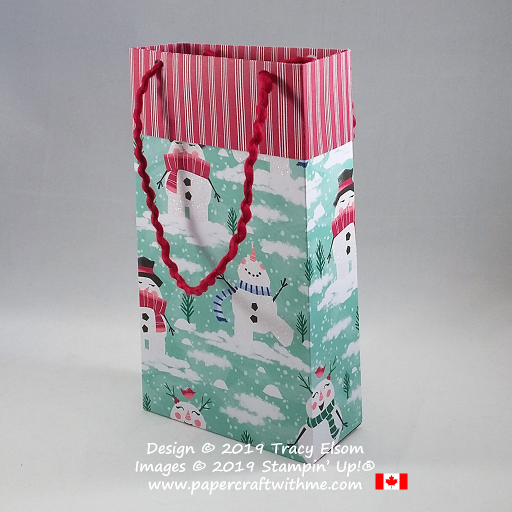 """Simple 4"""" x 7"""" x 1-3/4"""" gift bag made using the Let It Snow DSP and Curly Ribbon from Stampin' Up! #papercraftwithme"""