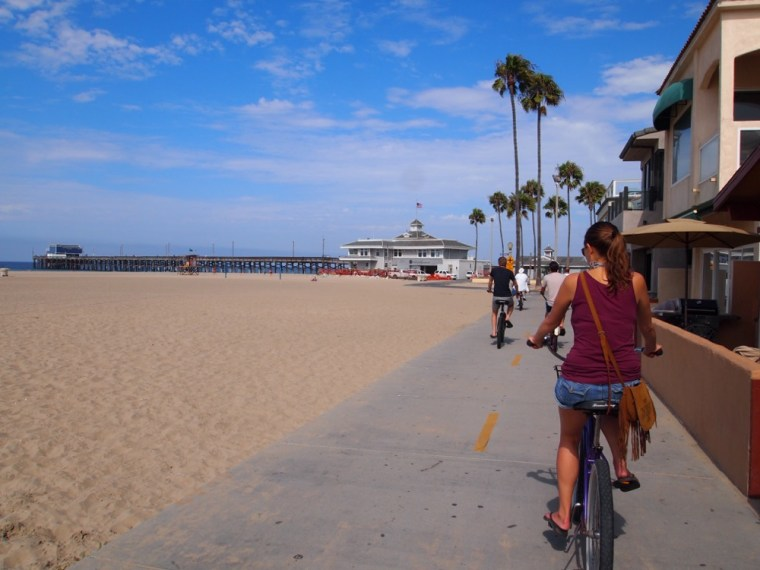 Cycling up Newport Beach Boardwalk
