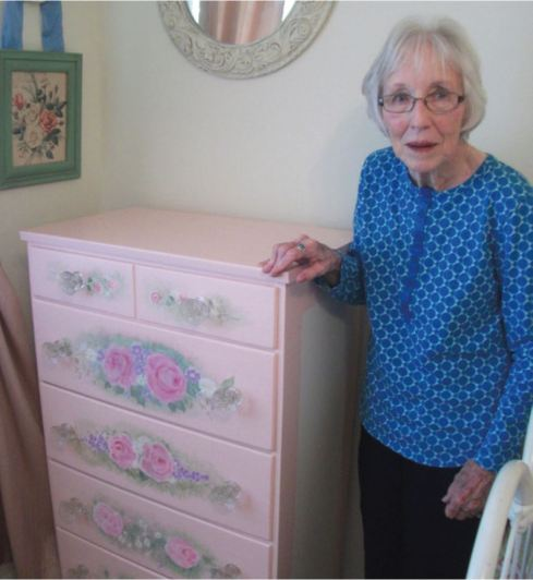 Helen Shinpaugh with a lovely dresser she decorated.