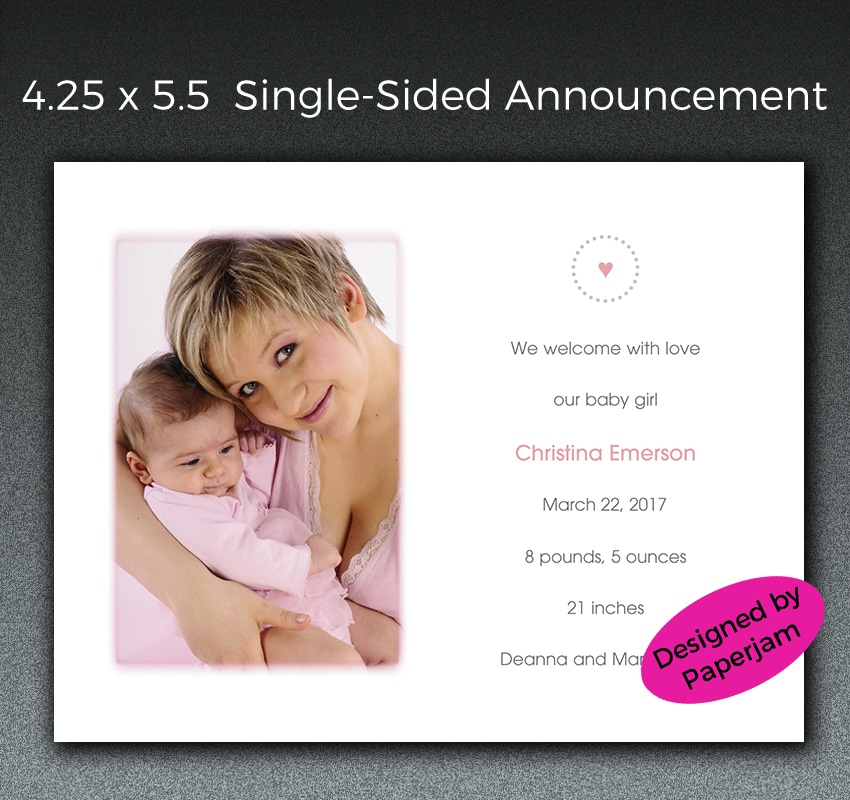 This petite birth announcement is accented with dusty pink and charcoal gray, including a heart motif along with a tinted vignette around the cropped photo.