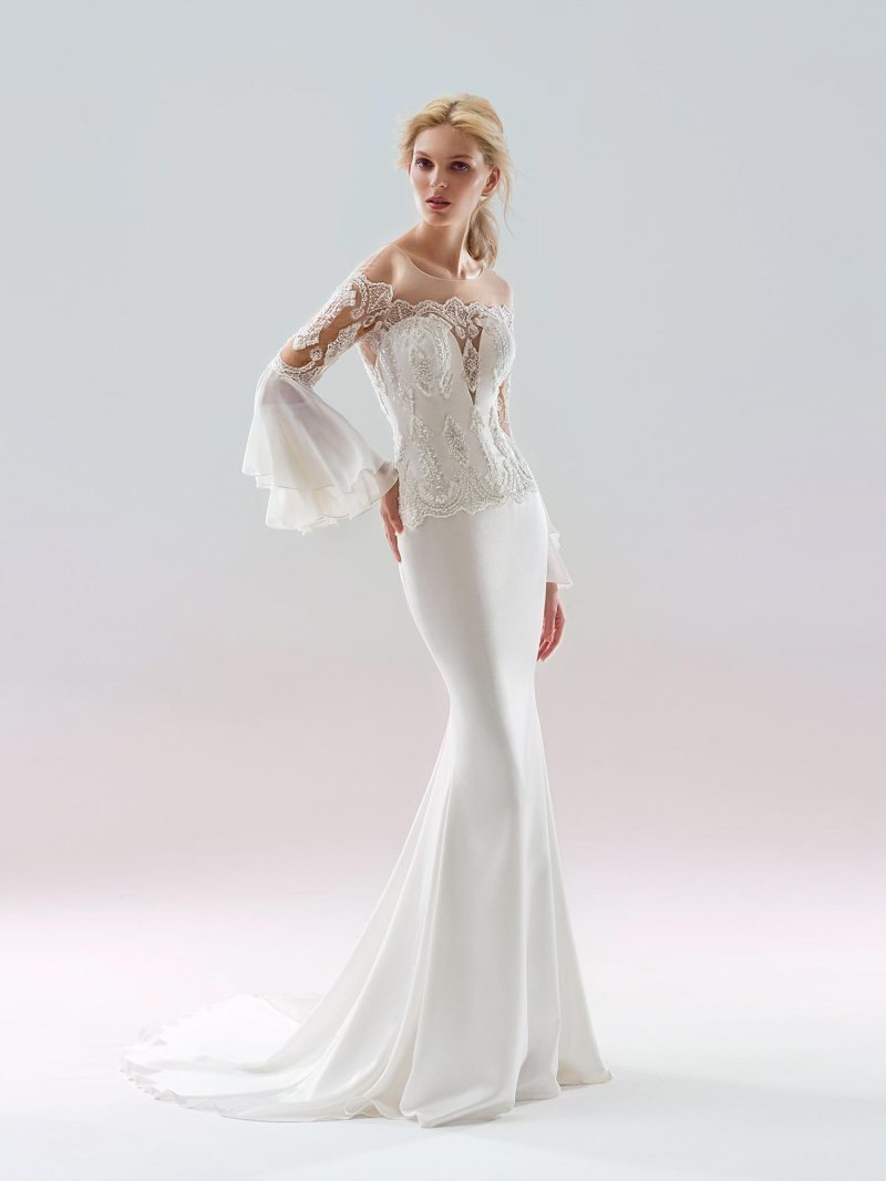 Fit and flare wedding dress with bell sleeves and an illusion neckline