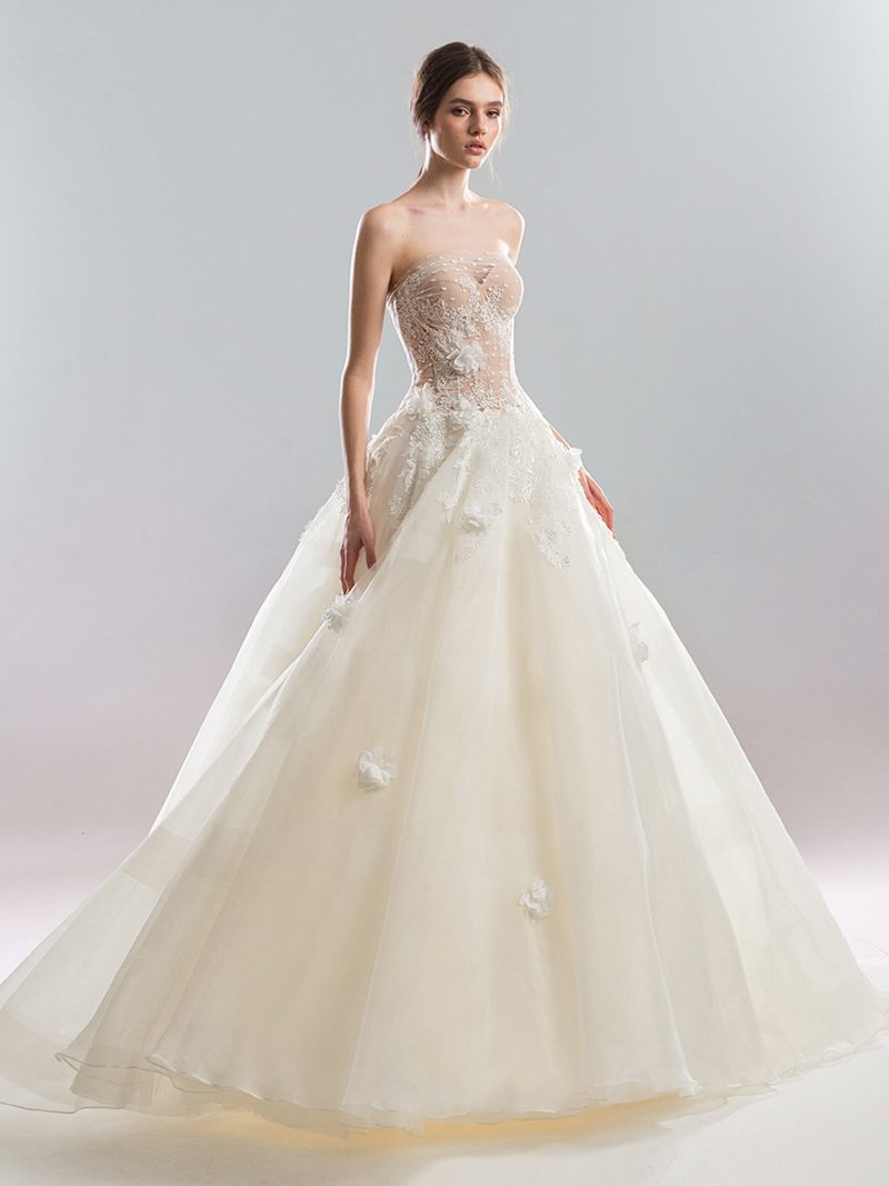 Strapless ball gown wedding dress with floral applique and sheer overlay