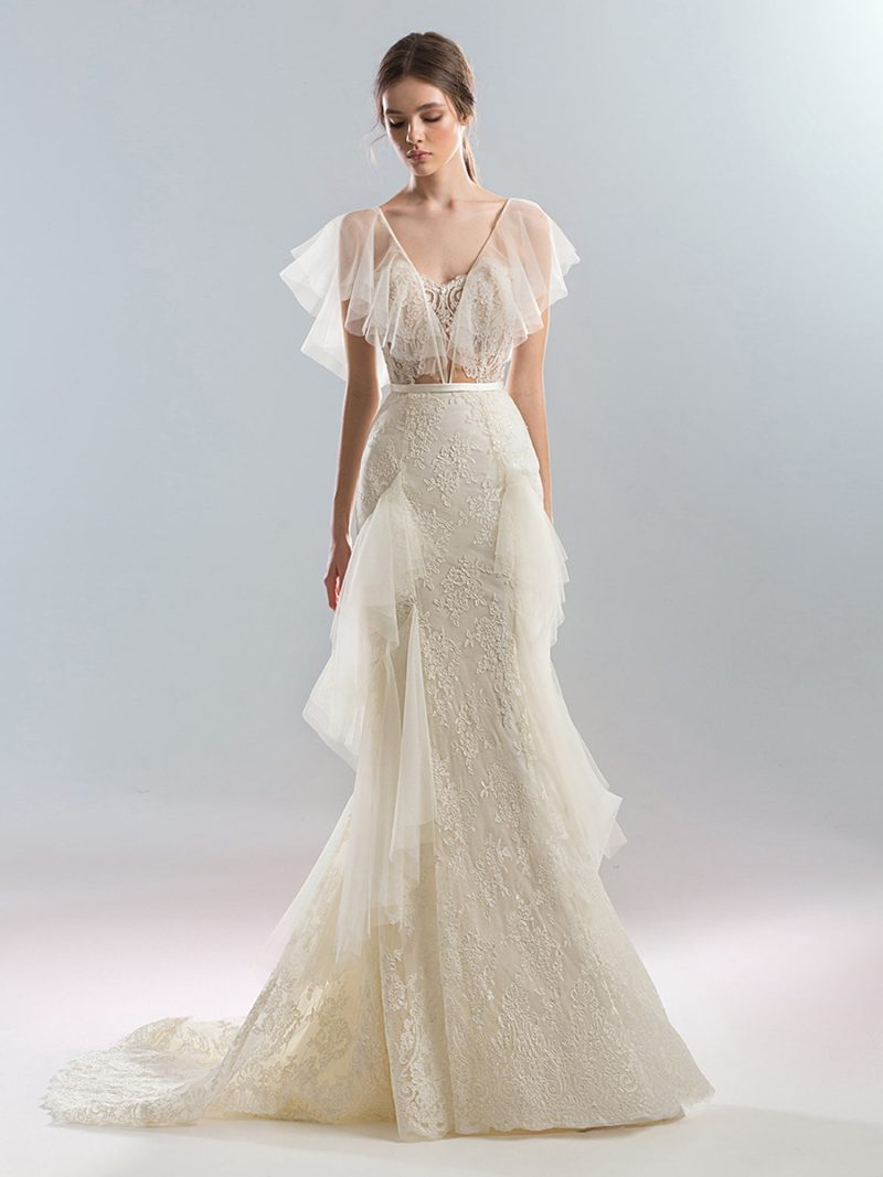 Fitted wedding dress with ruffle details and a sweetheart bodice