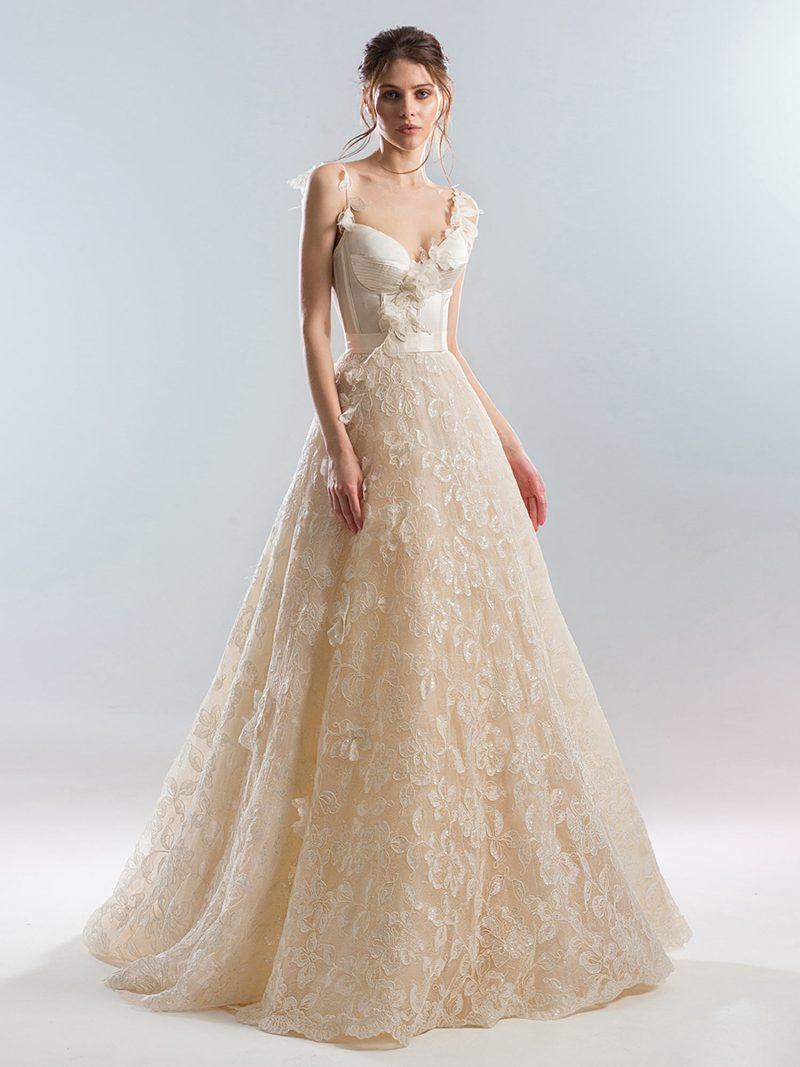 Bustier style A-line wedding dress with beaded lace skirt and 3D flowers
