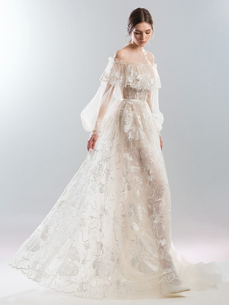 Off the shoulder wedding gown with bishop sleeves and metallic florals