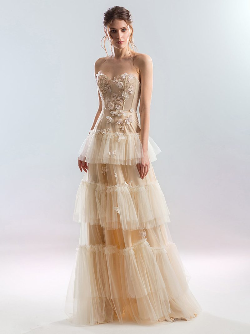 Strapless A-line wedding dress with tiered skirt and floral décor