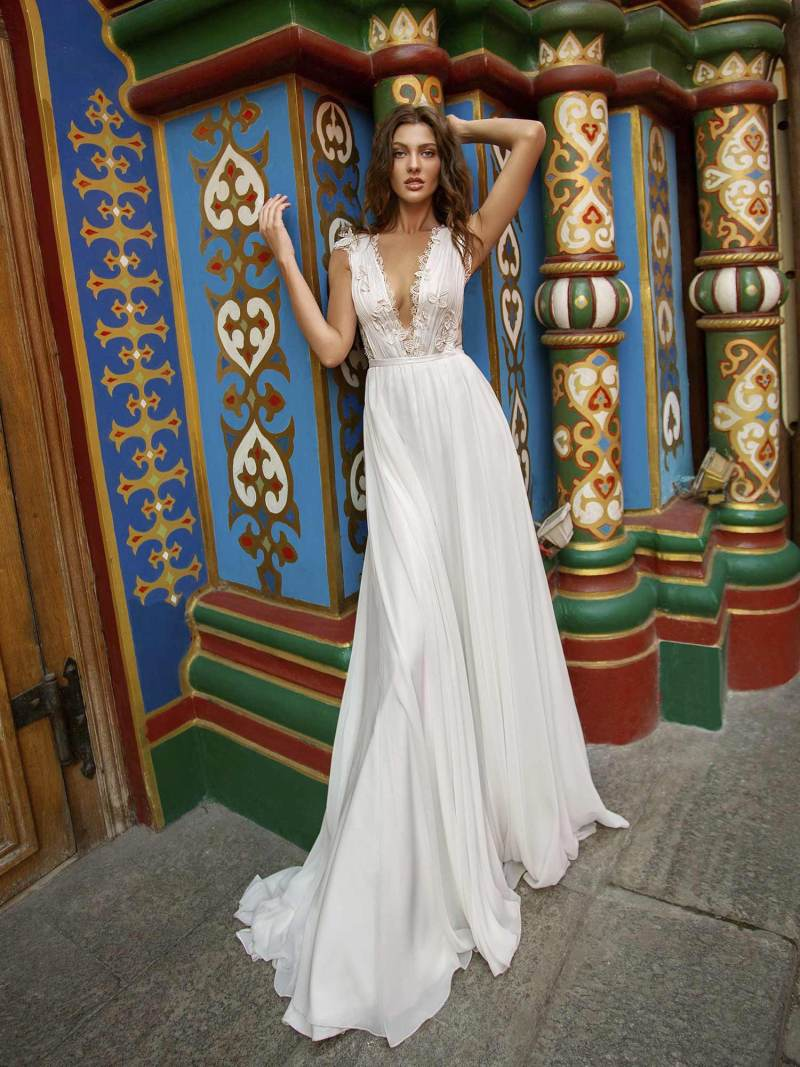 Sheath wedding dress with plunging neckline and back