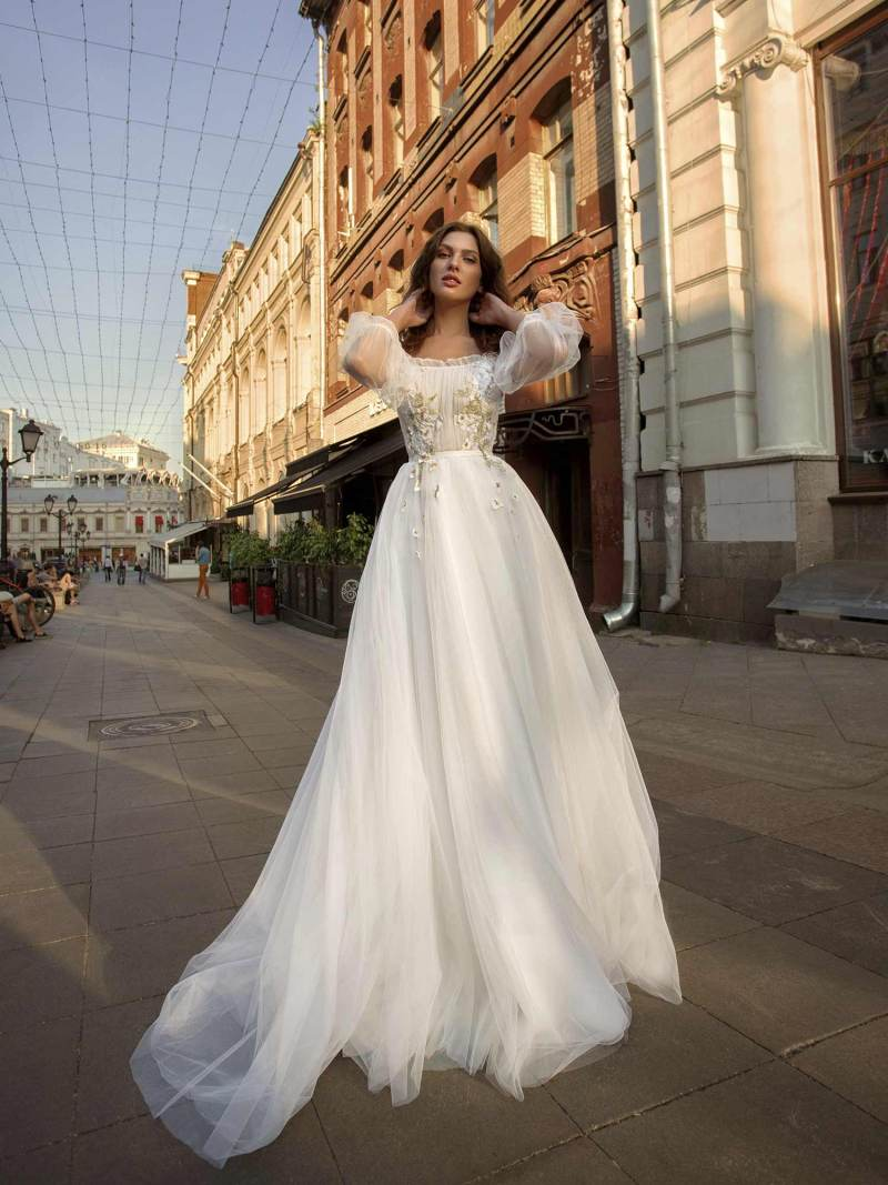 A-line wedding gown with an off-the-shoulder neckline