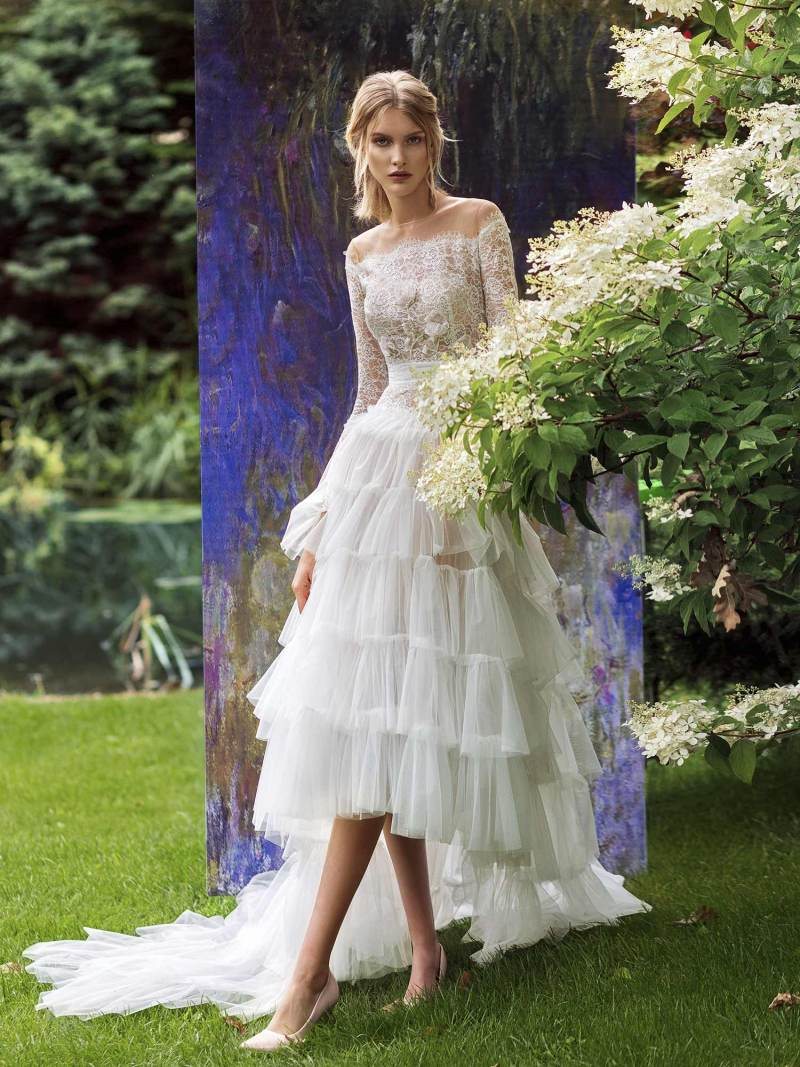 High-low wedding dress with layered ruffled skirt