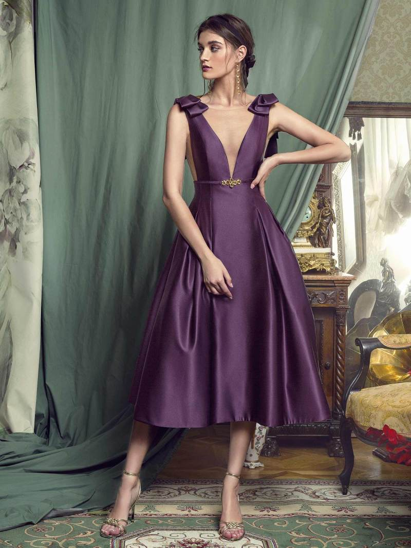 Evening gown with plunging neckline and voluminous skirt