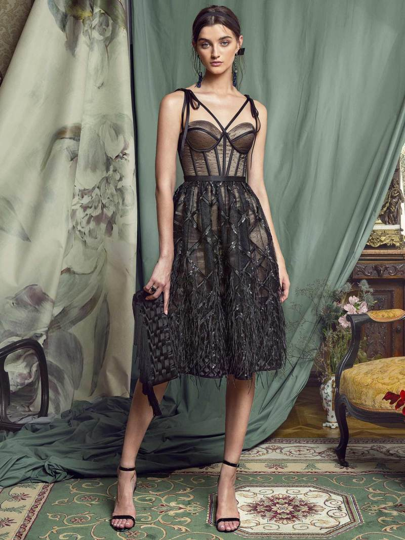 A-line cocktail dress with feathered skirt and bustier bodice