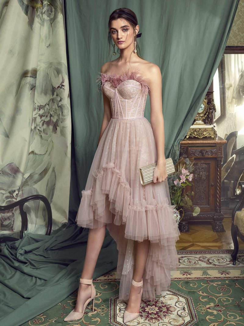 High-low cocktail gown with feathered bustier bodice