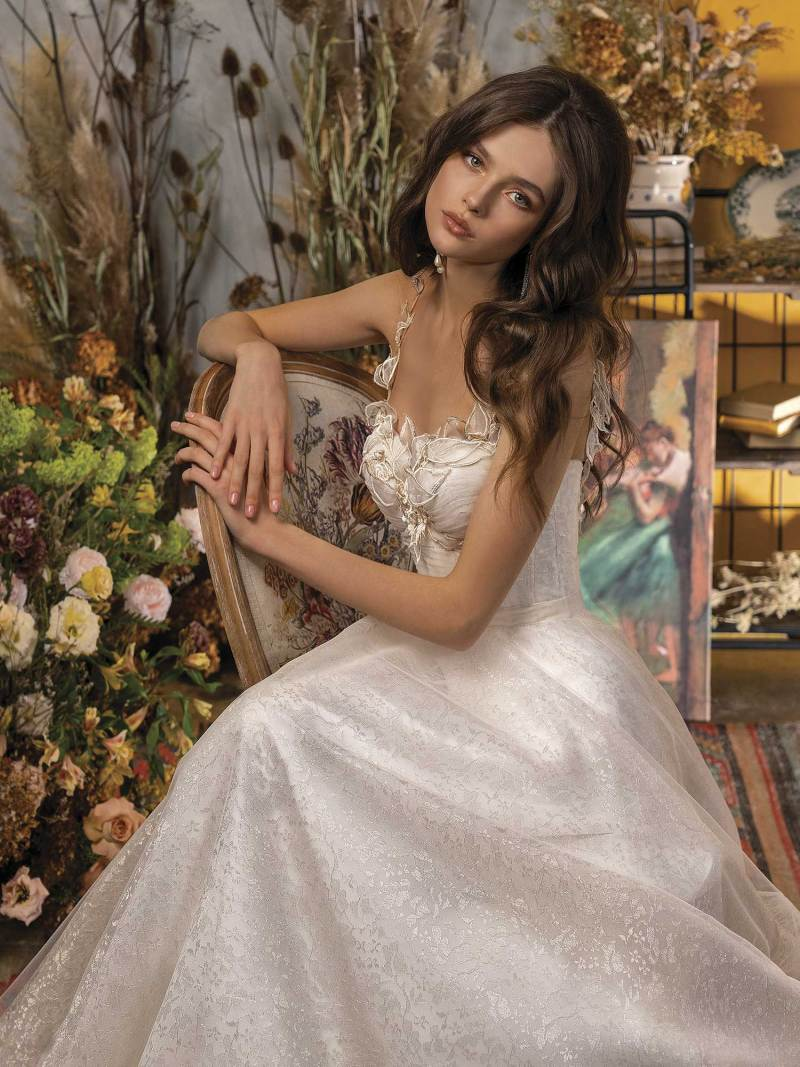 A-line wedding dress with bustier bodice and floral embroidery
