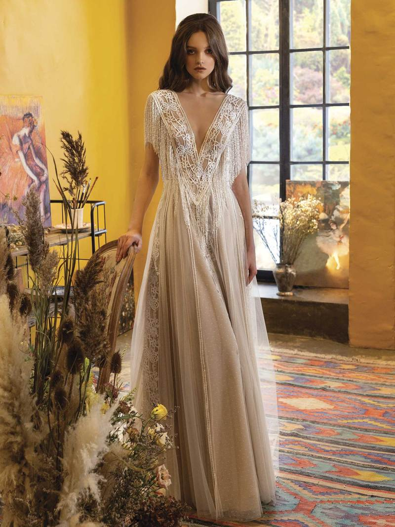 A-line wedding dress with plunging neckline and fringe