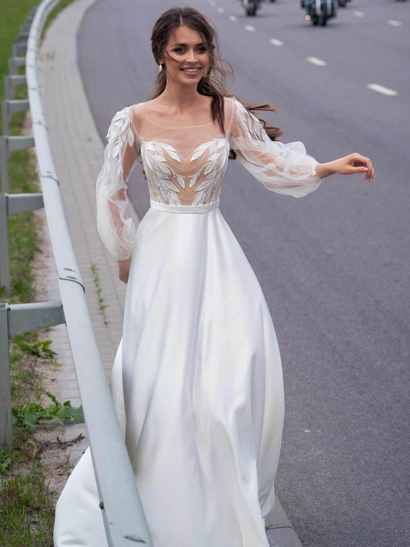 Wedding gown with embroidery and bishop sleeves