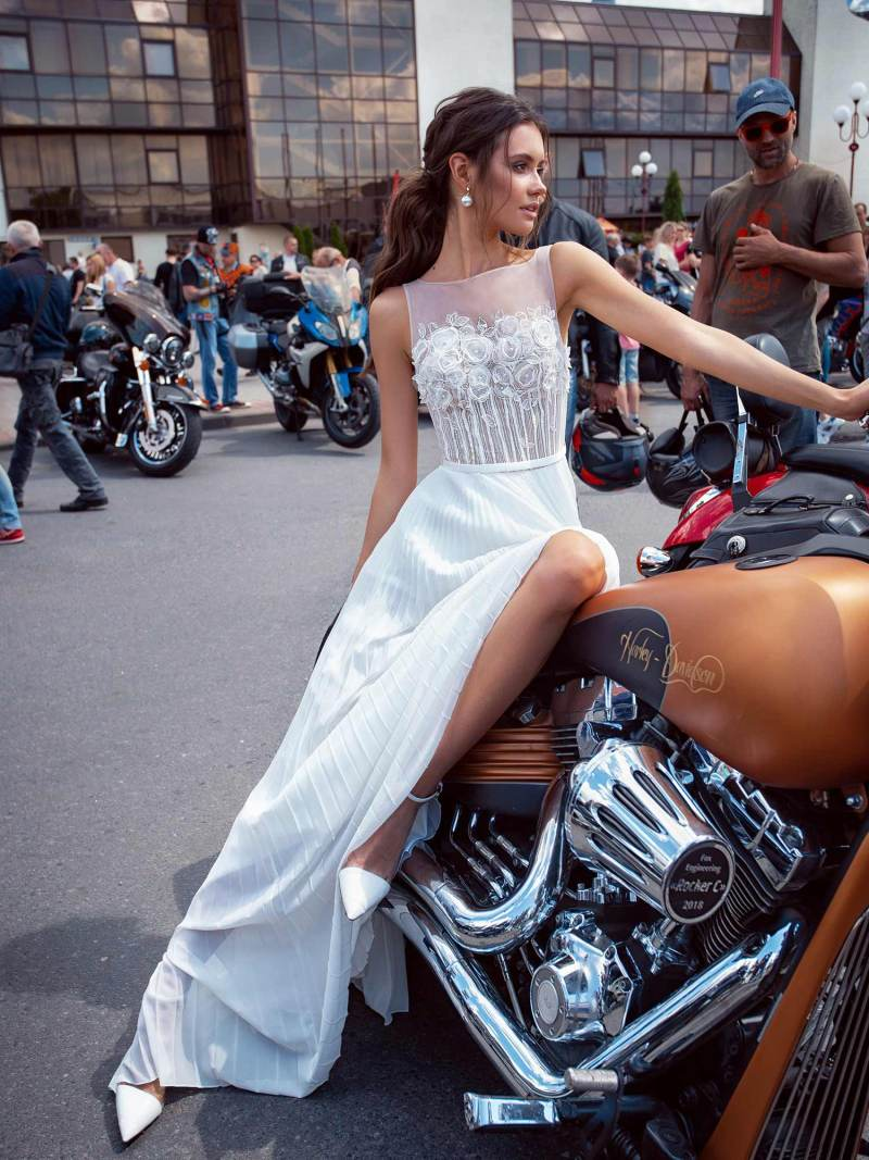 Simple wedding dress with floral applique and pleated skirt