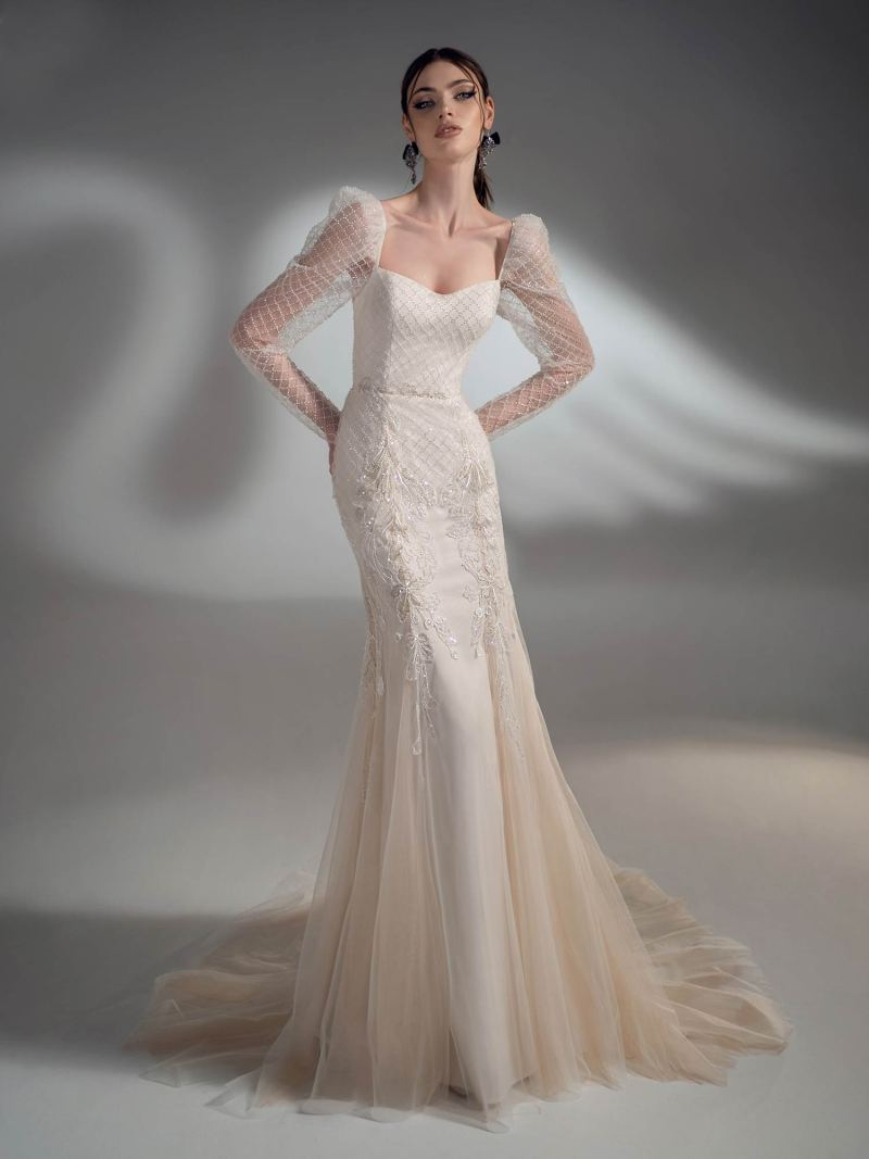 Sparkling fit and flare wedding dress with long sleeves
