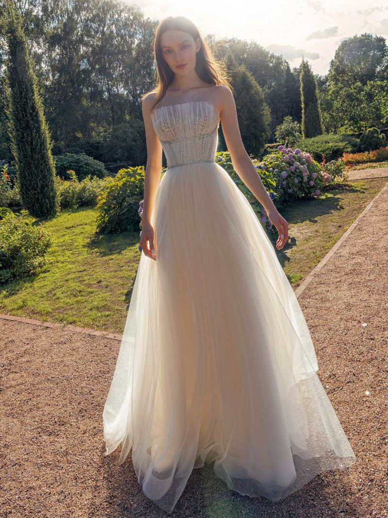 Strapless A-line wedding dress with frilled tulle neckline and sequined bodice