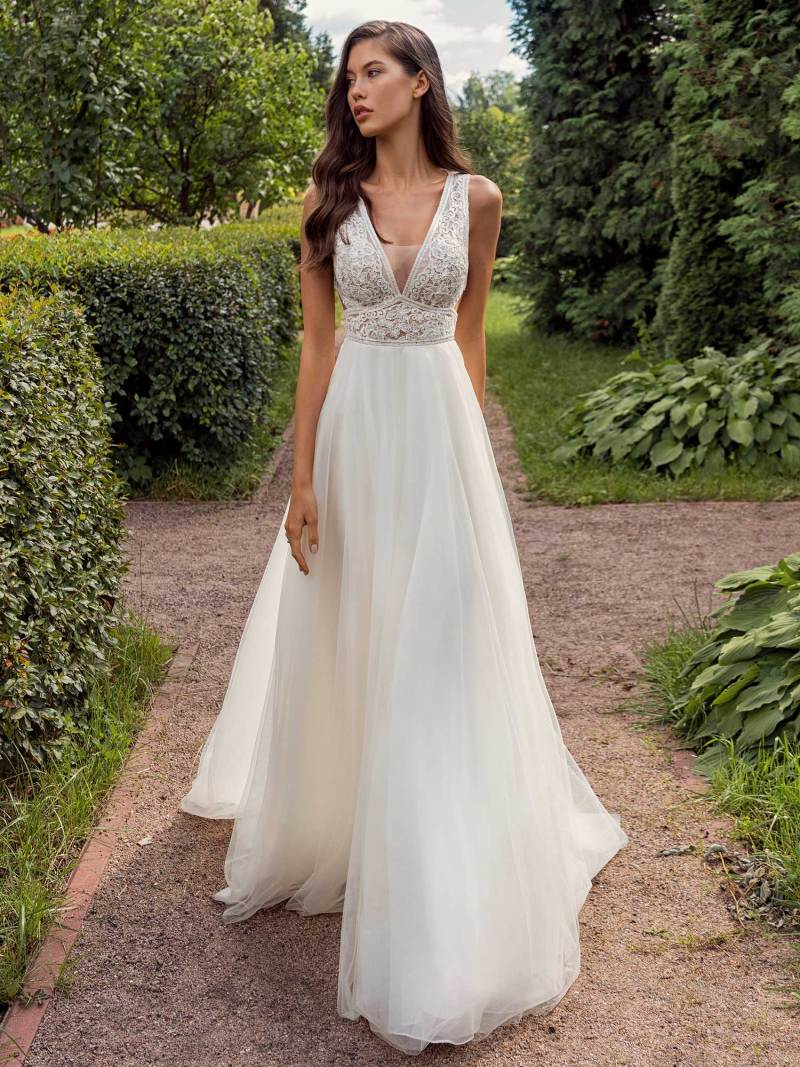 A-line wedding dress with a deep V-neckline lace bodice and tulle skirt