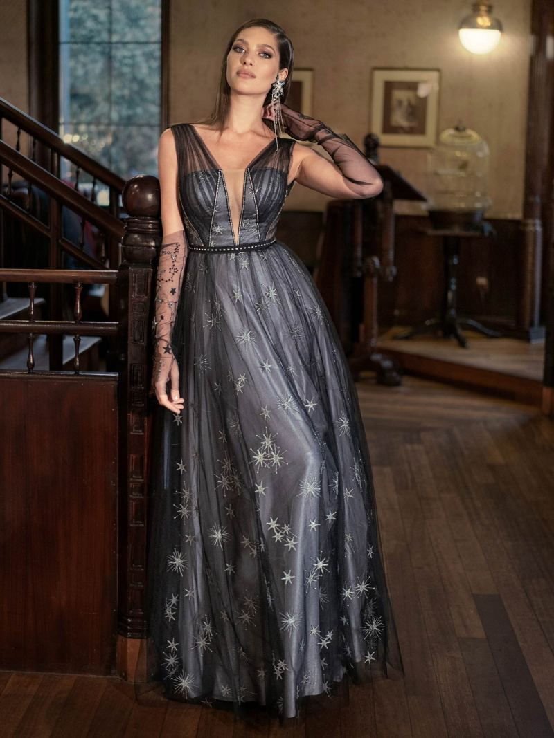 Deep V-neckline evening gown with star embroidery