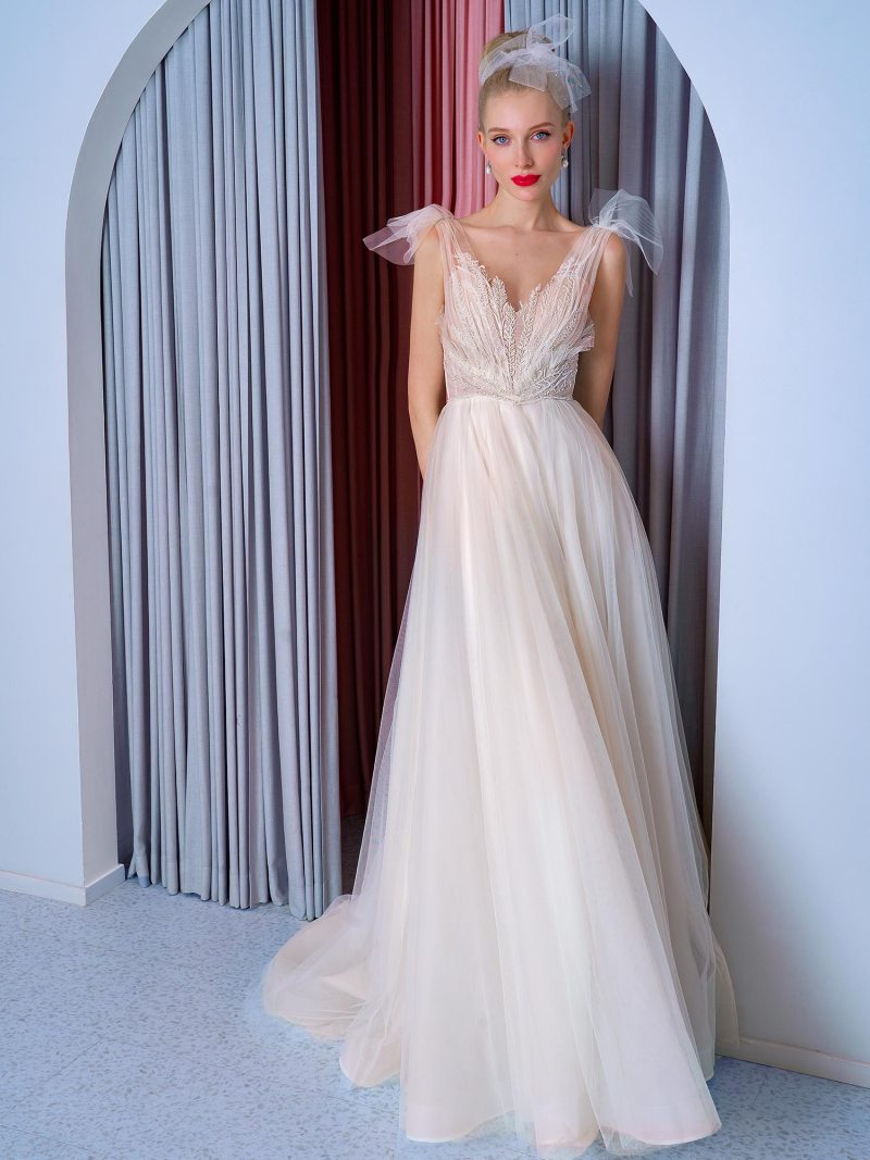 A-line wedding dress with bow straps and floral embroidered top