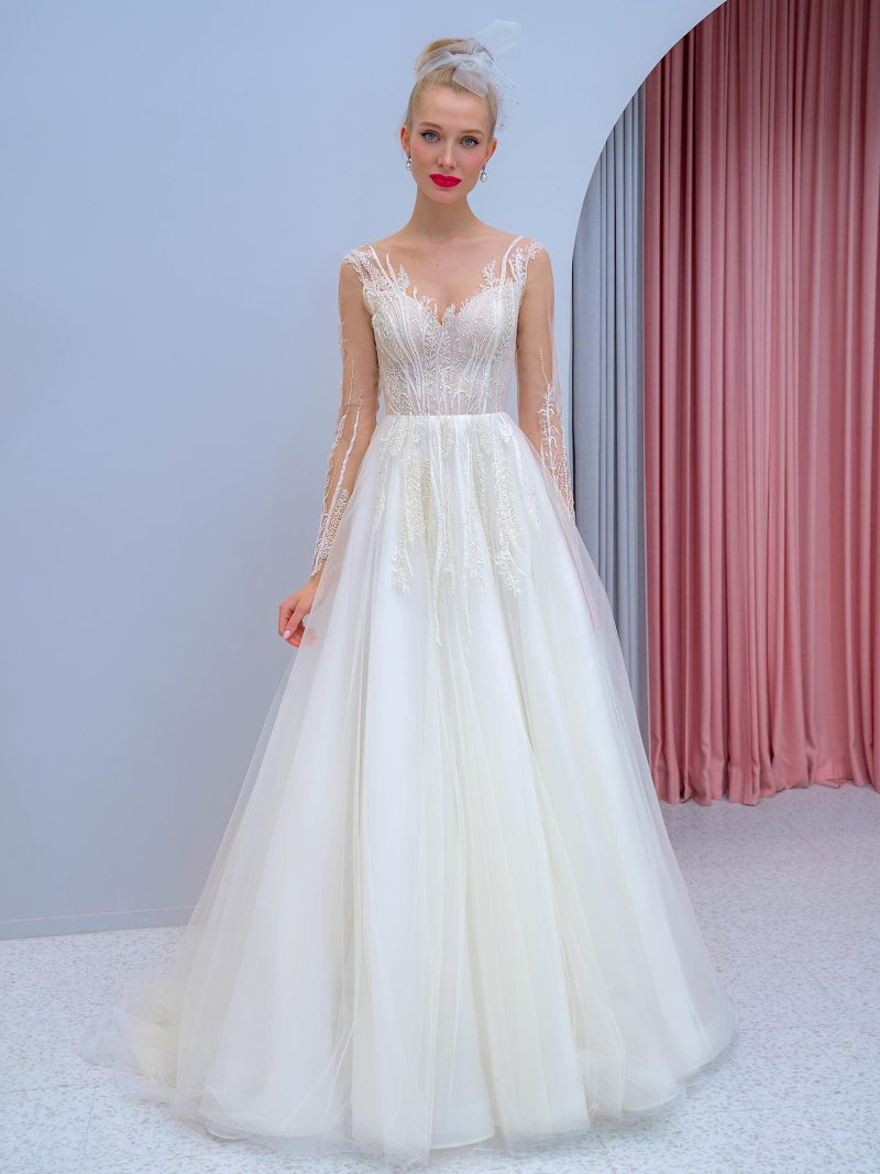 Long-sleeve A-line wedding dress with floral embroidery