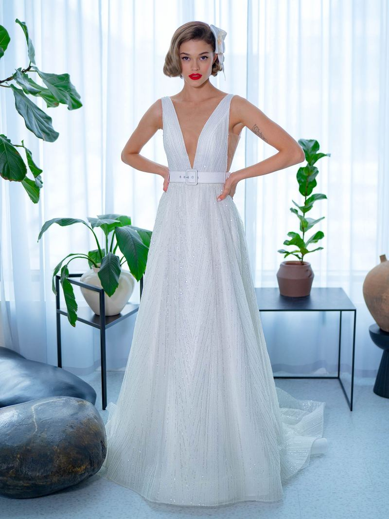Sequinned lace A-line wedding dress with V neckline and belt