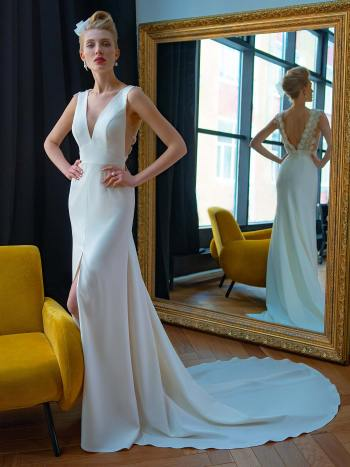 Crepe fit and flare wedding dress with floral back