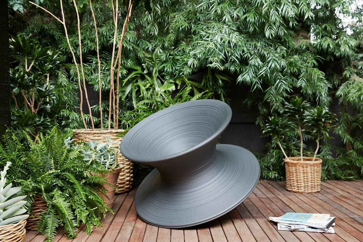 spinning top chair south africa pottery barn seagrass magis spun papillon garden landscape design