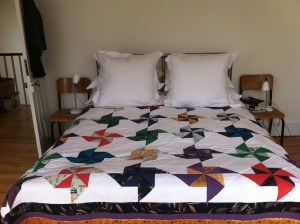 Cotton, silk, bamboo quilt. modern and vintage fabrics in a pinwheel design.