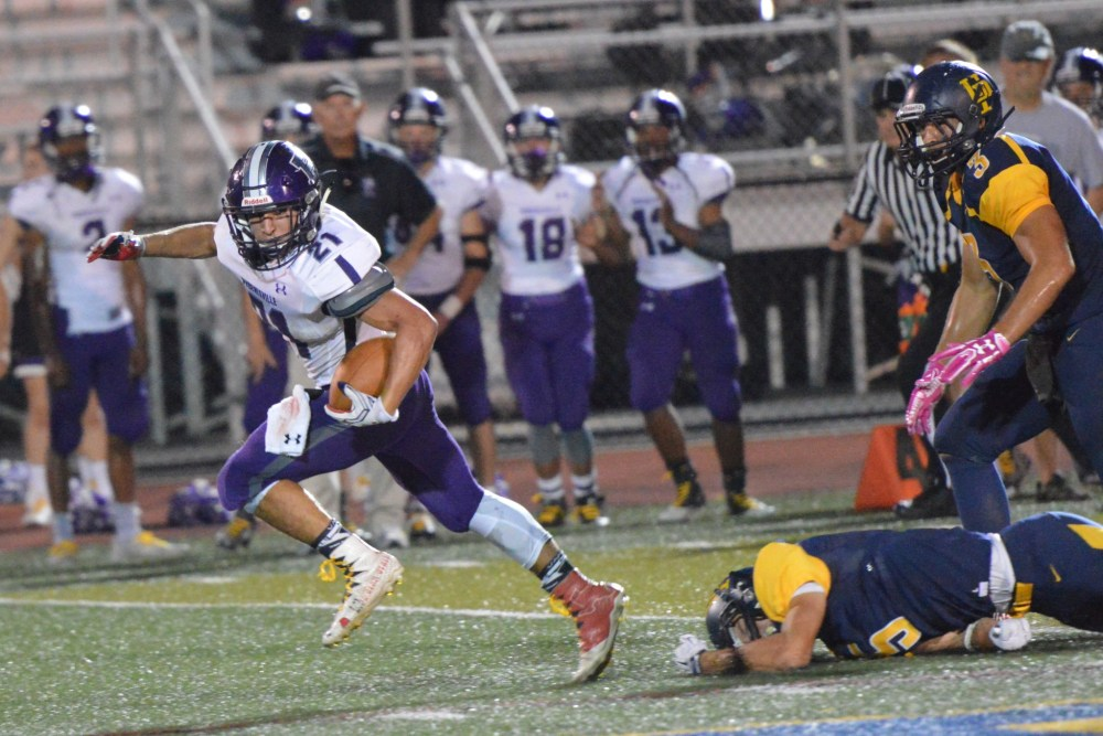 Phoenixville's Matt Garcia breaks through the Upper Perkiomen secondary en route to a 64-yard touchdown run during the first quarter. (Sam Stewart - Digital First Media)