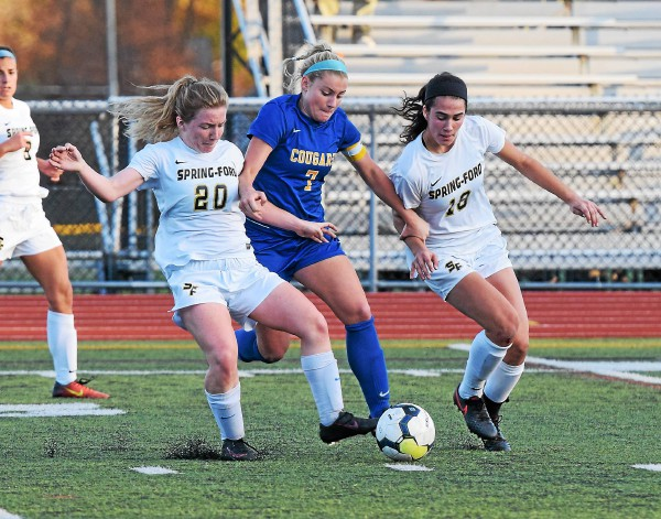 Downingtown East's Emma Steigerwald, center, battles for the ball with Spring-Ford's Gabby Kane (20) and Laura Fazzini. (Austin Hertzog - Digital First Media)