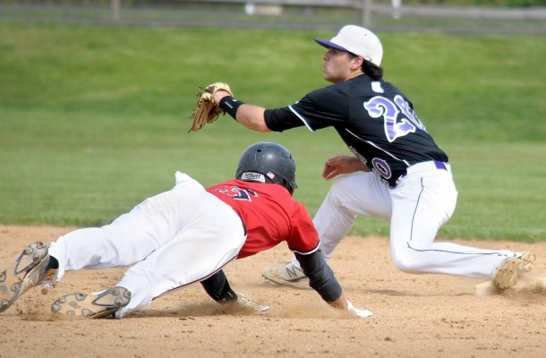 Upper Dublin's Thomas Reilly dives towards second for a stolen base as Upper Moreland's Paul Ciampoli waits for the throw. (Gene Walsh/Digital First Media)
