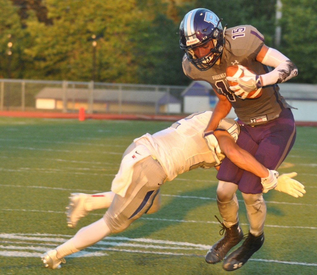 Phoenixville's Shyheim Abernathy looks to break away from Great Valley's Ryan Hubley. (Barry Taglieber - For Digital First Media)
