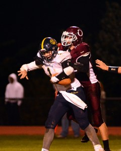 Oxford's Patrick Kinsella gets a sack of Joe Zubilaga in the defense-heavy game