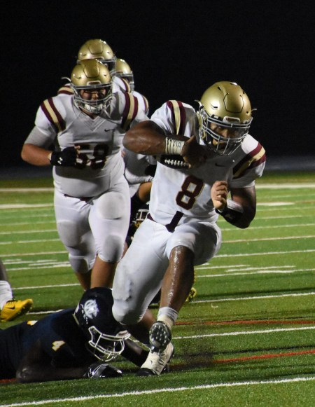 Haverford School's Mallik Twyman embarks on a power rush Friday night against West Catholic in what became a superb, back-and-forth game won by the Fords at Widener University. (Digital First Media/Anne Neborak)