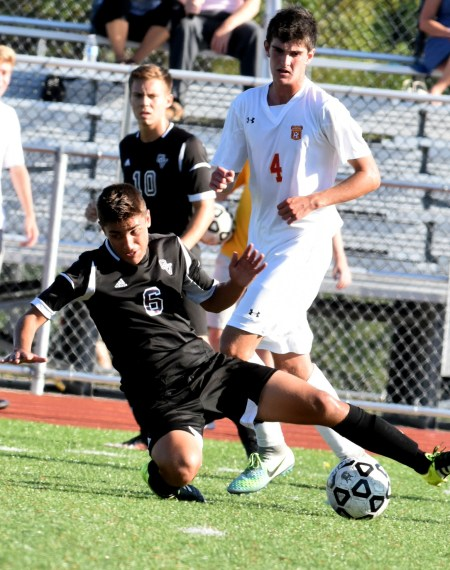 Garnet Valley midfielder Jacob Schwien tackles the ball away from Haverford High's Chris Rose in Tuesday's Central League match.  (Digital First Media/Anne Neborak)