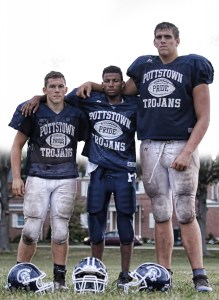 Sam Stewart — Digital First Media Marvin Pearson, flanked by Zack Griffin, left, and Draeden Gwinner, right, returned to Pottstown for his senior season and is a member of the Trojans' team despite being blind since elementary school.