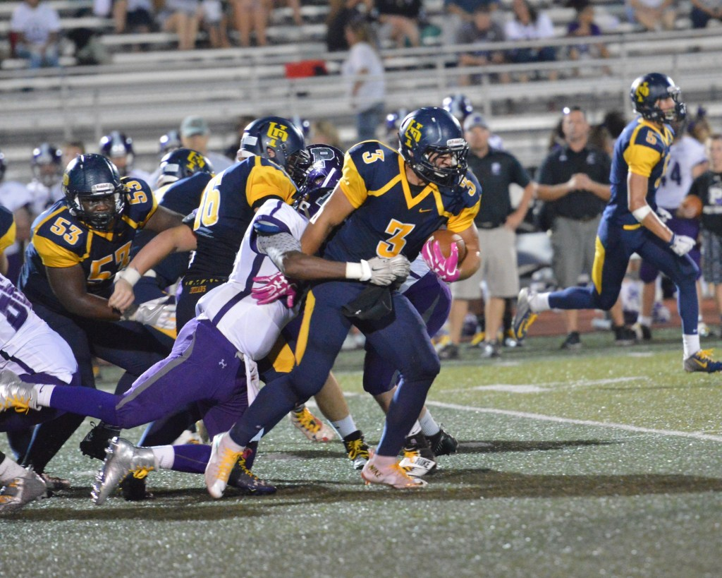 Upper Perkiomen's Austin Tutolo drags a Phoenixville defender with him en route to a first down. (Sam Stewart - Digital First Media)