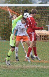 Perkiomen Valley goalkeeper Andrew Daubenspeck and defender Max Chamorro try to clear the ball as Owen J. Roberts' Nolan Smith attempts the header during the first half Wednesday. (Austin Hertzog - Digital First Media)